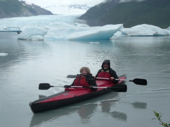 Sheryl and Jim kayaking on Spencer Lake amongst the icebergs created by the Spencer Glacier